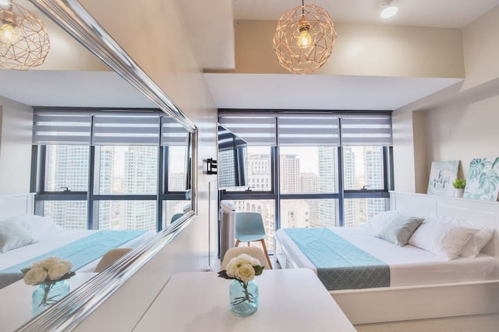 Your chic & cozy Eastwood City home away from home