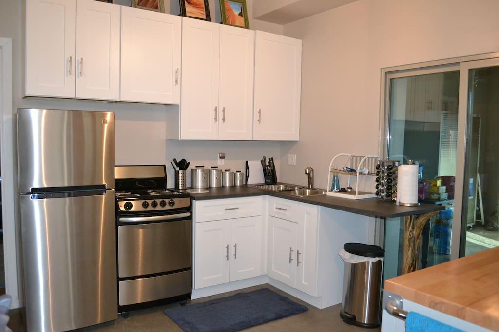 Kitchen has electric range, oven, refrigerator, microwave, garbage disposal, coffee/tea pot, basic cooking utensils, pots, pans and skillets, plates, bowls, cups, glasses just in case you want to stay in for dinner.