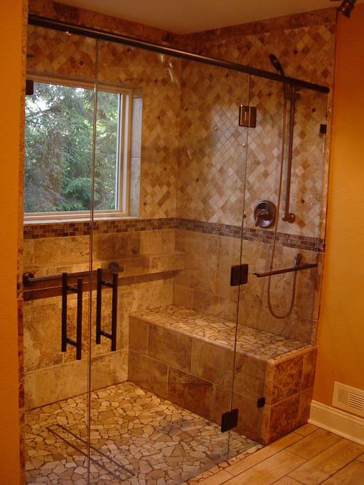 Ensuite shower.  Easily accessible master shower. 3 different shower heads to make it easy to shower standing or seated.