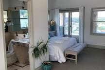 Master suite with King bed, television, gorgeous panoramic view, private en suite full bath, balcony and coffee station.