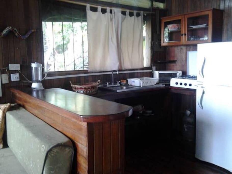 Coffee maker, toaster oven and stove with refridge