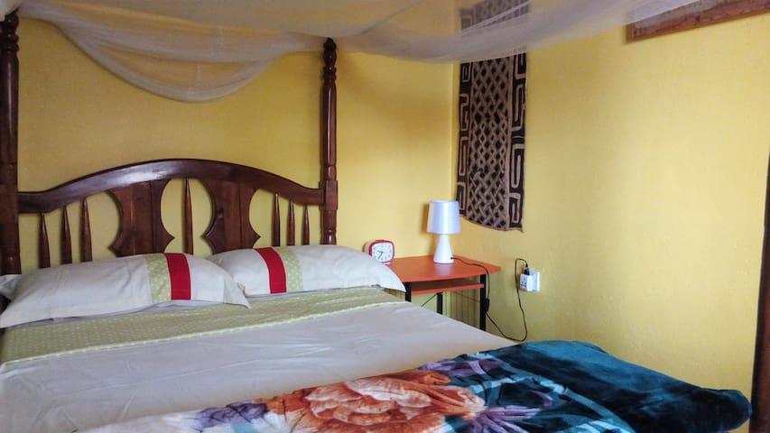 Kampala Jungle Guest rooms in beautiful gardens