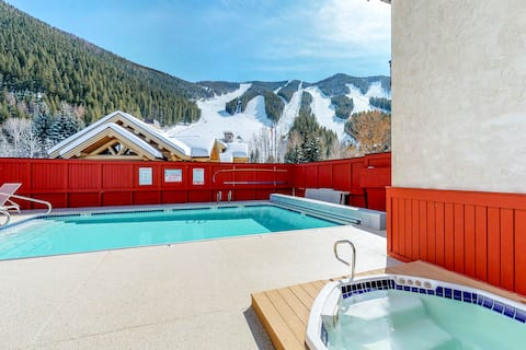 Ski-in/ski-out alpine condo with shared seasonal pool, hot tub, sauna, & views
