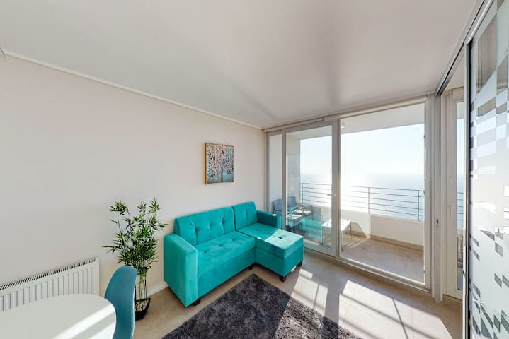 Colorful apartment with breathtaking ocean views from balcony and a shared pool