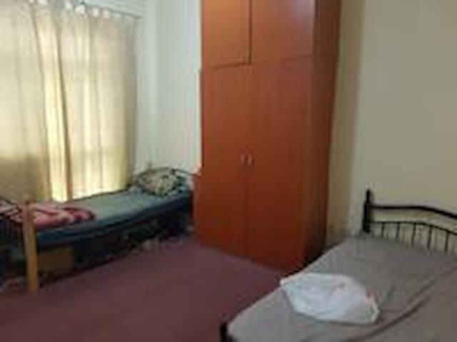 Room with 2 beds for male bachelors