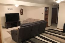 Relax on the couch and enjoy a movie on our 65 inch TV