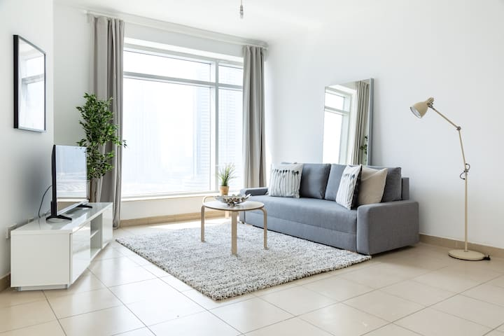 Living area with flat TV screen