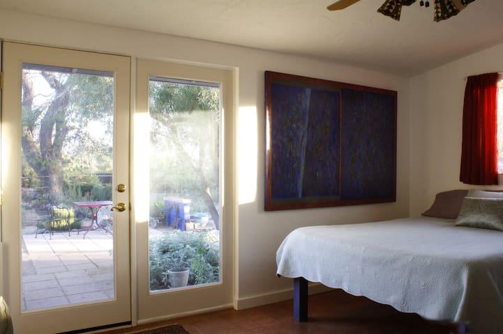 Summer bedding  inside guest room - garden outside