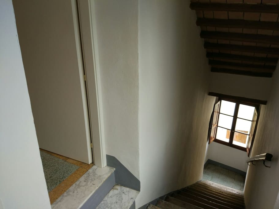 The stairs leading up to the apartment