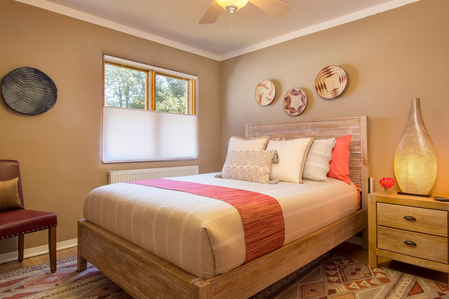 Tastefully decorated queen bedroom with luxury linens and comfortable mattress.