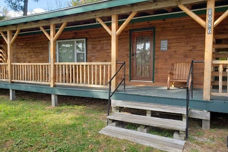 Green Log Cabin in Houghton Lake, MI