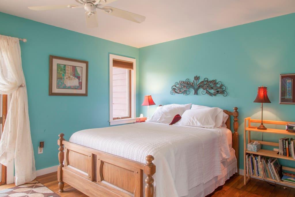 Queen bedroom with slider to deck-1