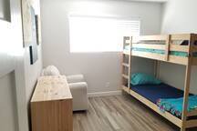 3rd Bedroom with bunk beds and rocking chair