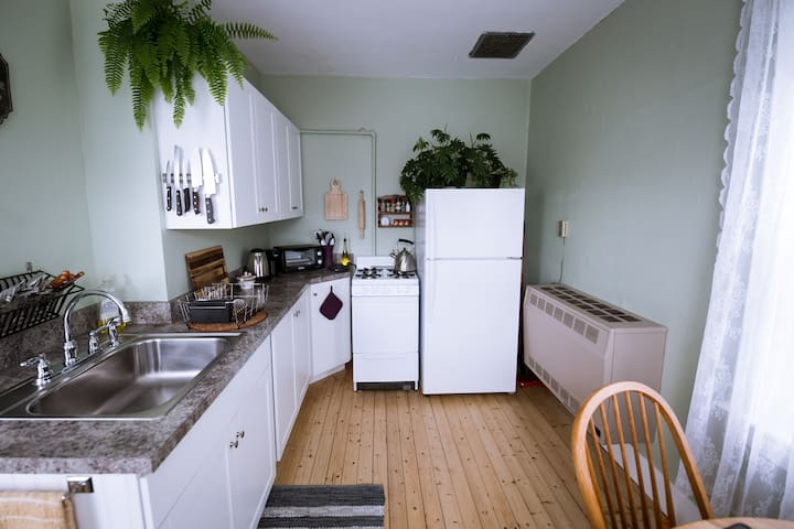 The recently remodeled kitchen is cute and inviting and has everything you need to feel right at home!