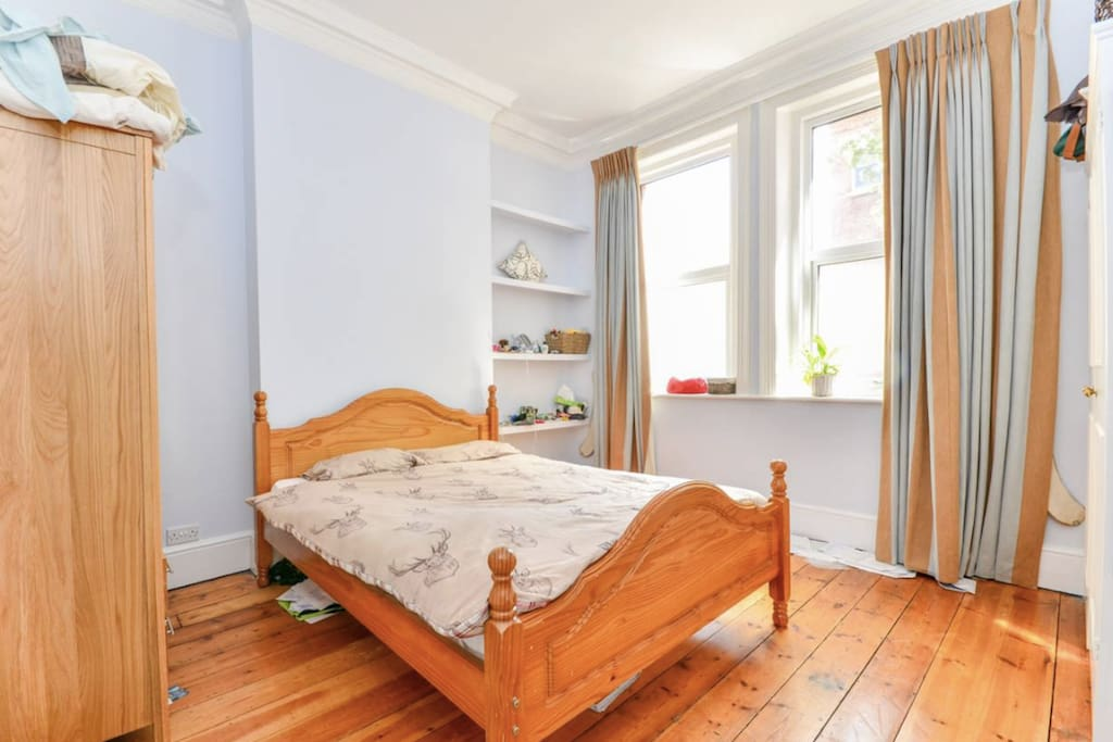 The large, light filled double bedroom you'll be staying in
