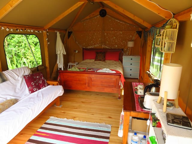 Inside the Glamping tent.  Beautiful lawson cypress wooden frame and Eucalyptus floor