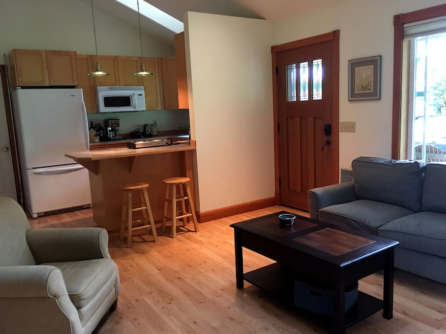 Living room, kitchenette, and door to porch.