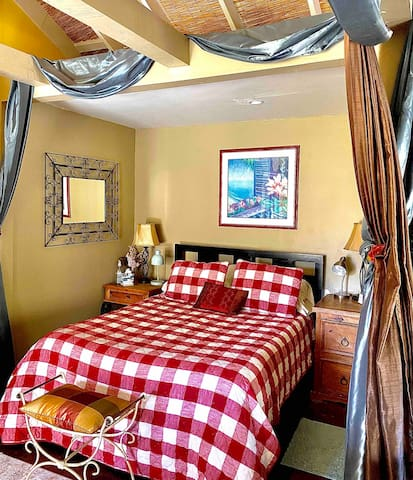 Cozy sleeping nook-ultra-comfortable queen bed with memory foam and luxury linens. Both nightstands have reading lights.