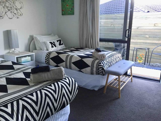 Twin single beds in room with own external entrance