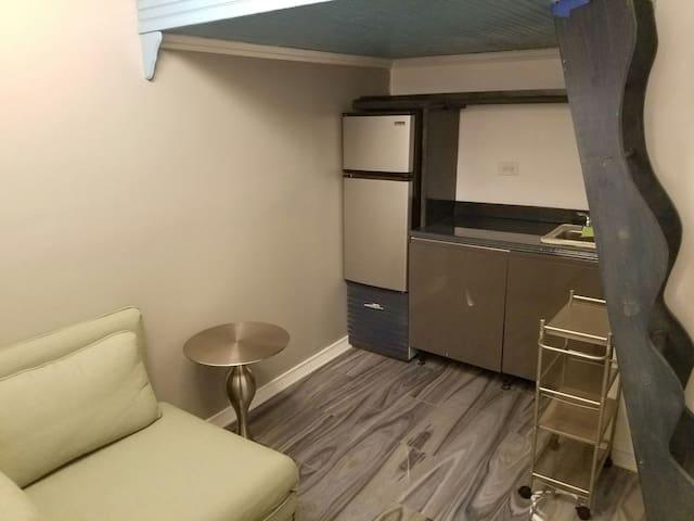 Dorm-style studio: pocket WiFi and mobile phone.