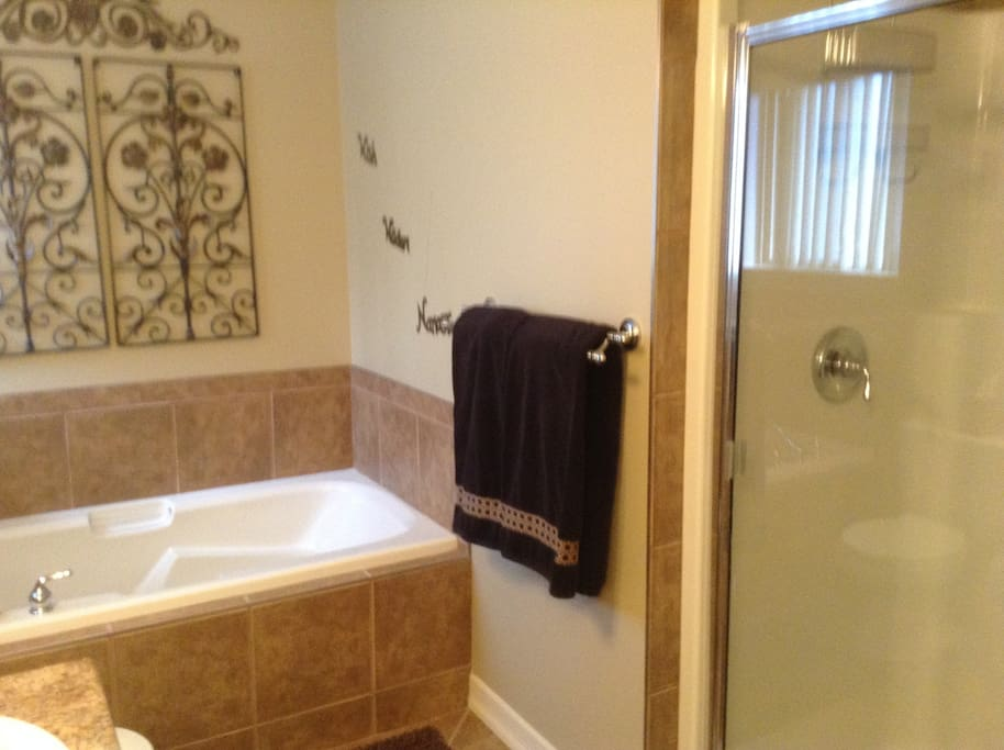 Separate shower and bath tub