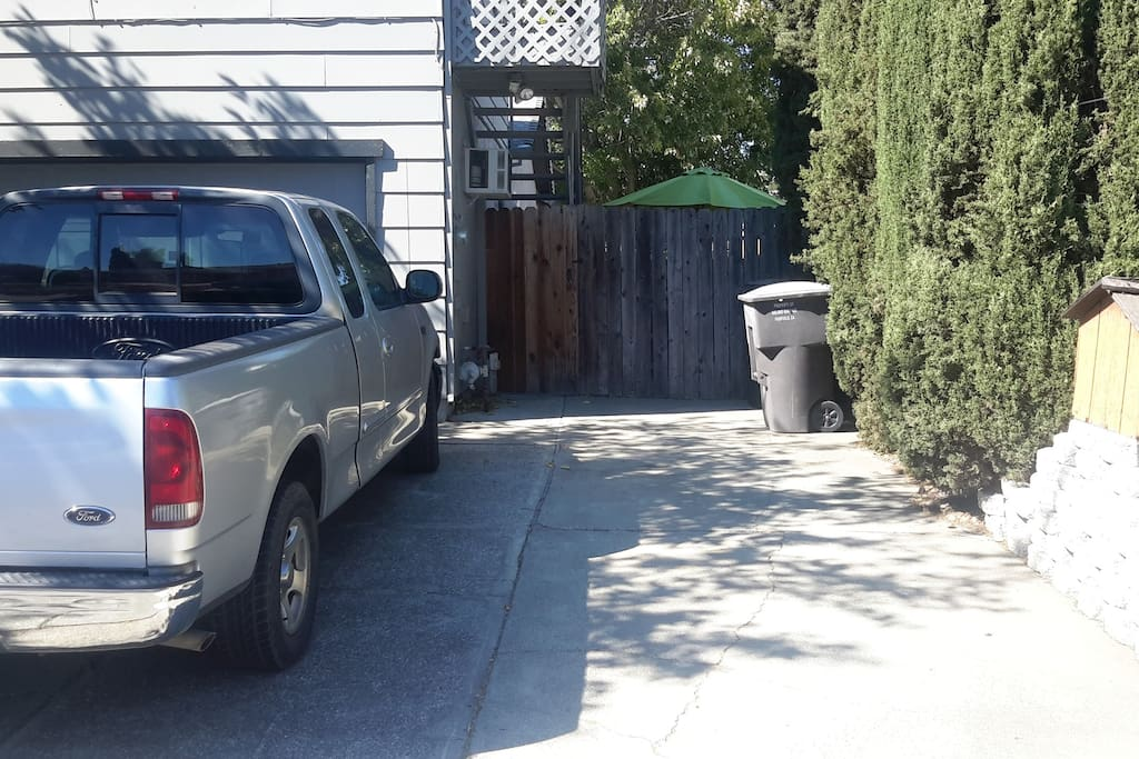 Driveway parking spot with private entrance.