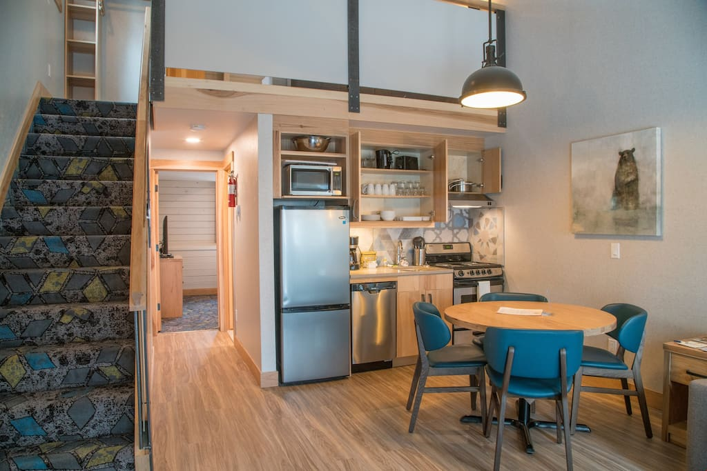 Our open and bright living area features a functional kitchenette and a dining area.