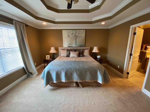 Bedroom attached to large bathroom