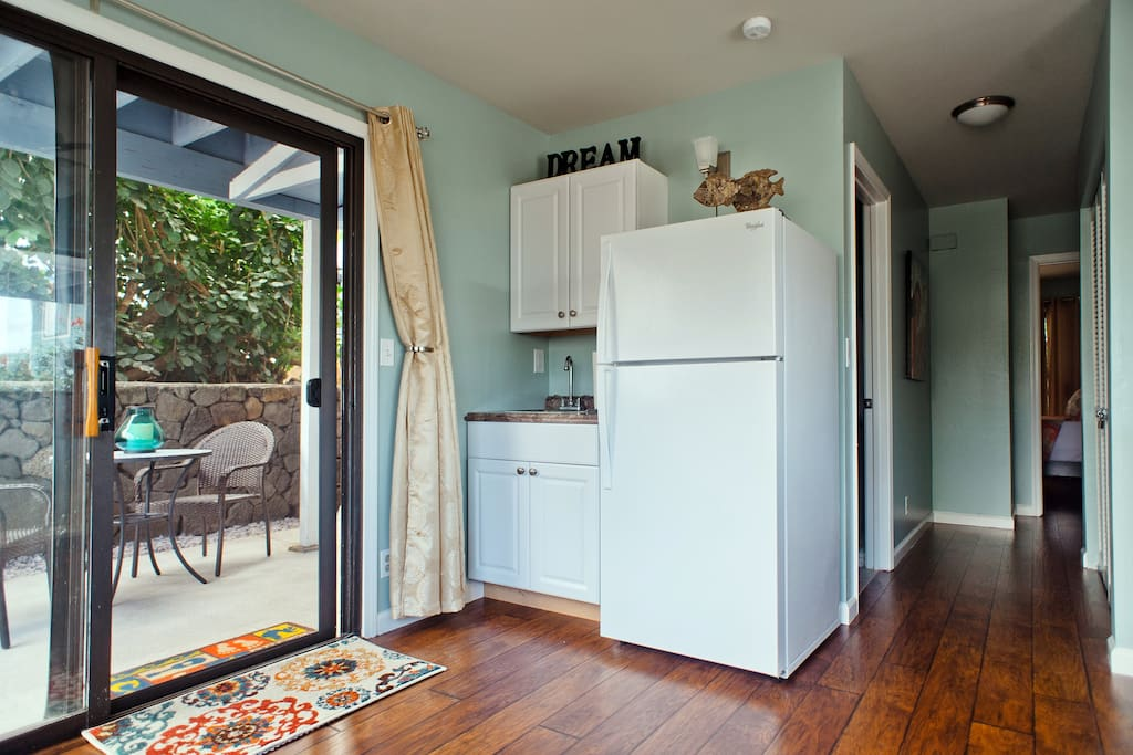 Kitchenette featuring: Full-size refrigerator and freezer, coffeemaker, sink, microwave, and toaster oven.