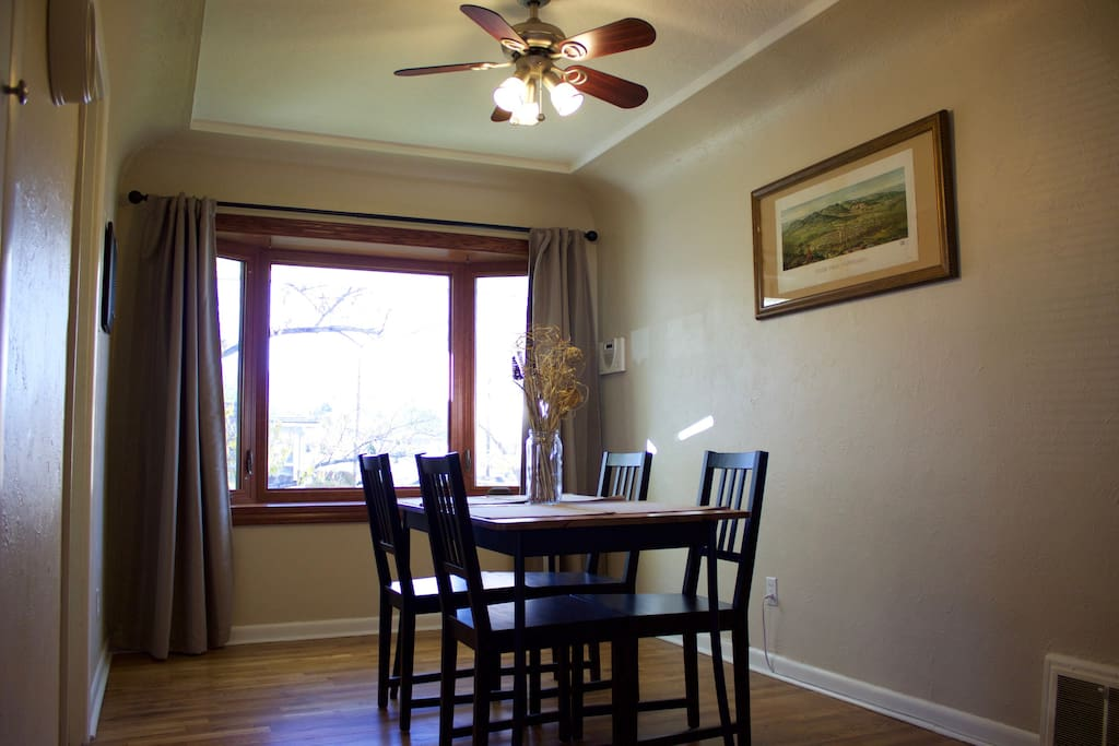 Dining room with bay window and Pikes Peak views