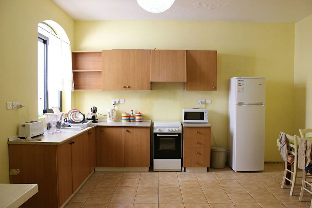 Big kitchen with all the amenities you would need for your stay