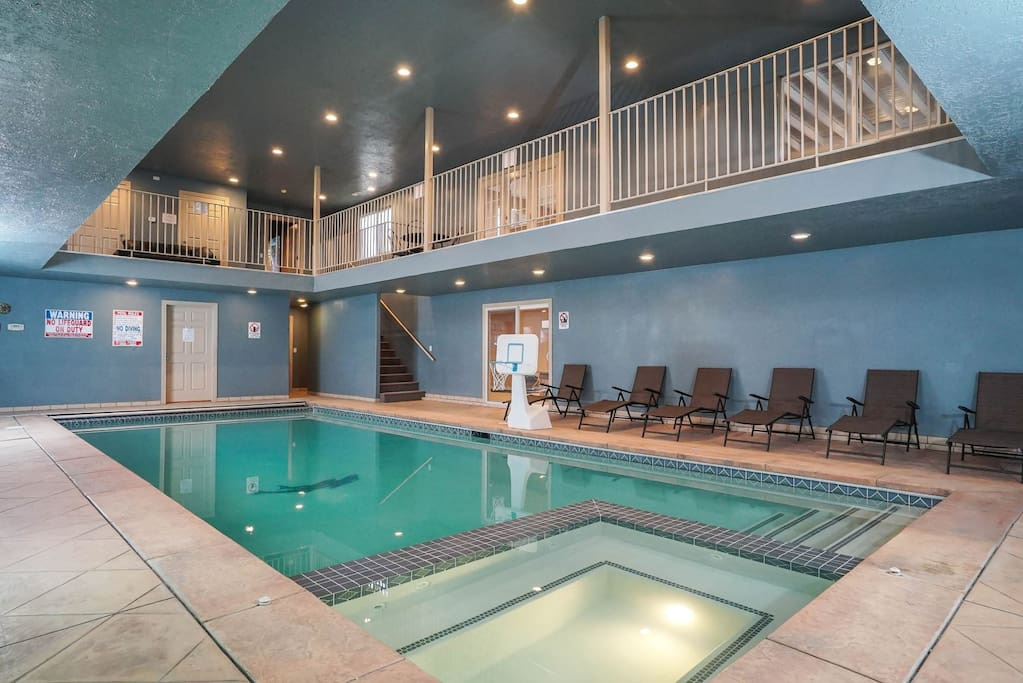 Private indoor hot tub connected to the pool
