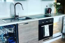 A fully equipped kitchen with a dishwasher, oven, fridge and everything you need to cook and bake.