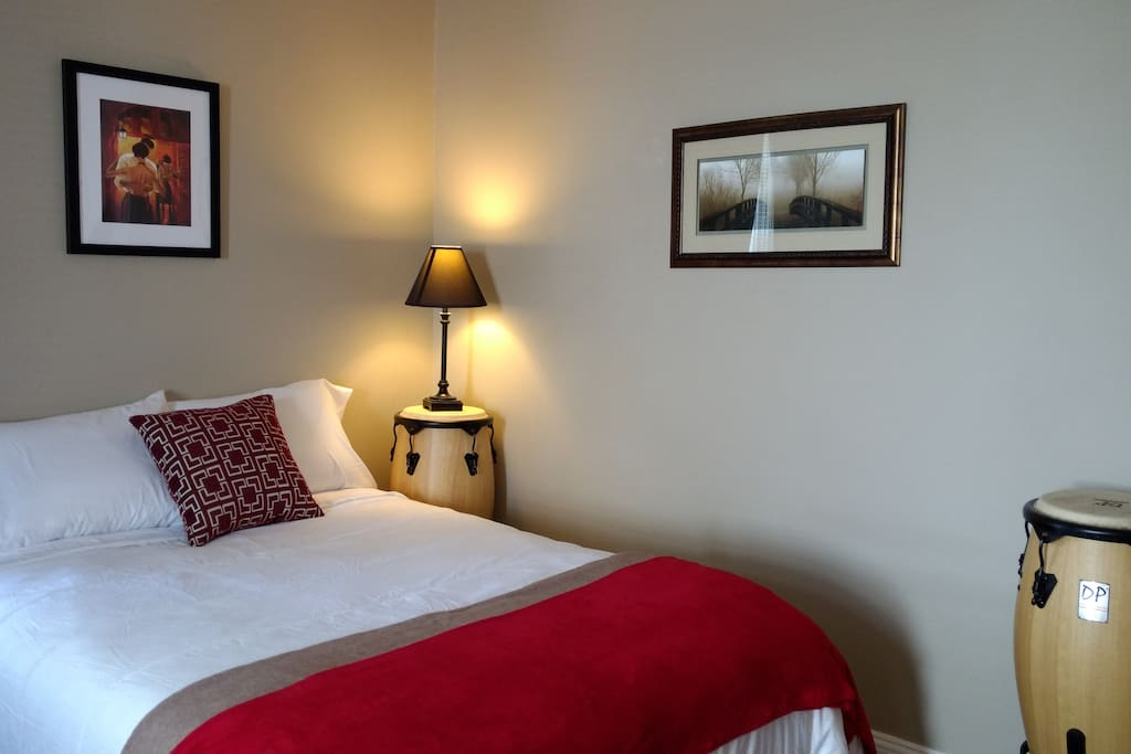 The Nick Carraway Room has two double beds with a private ensuite bathroom with a shower inside the room