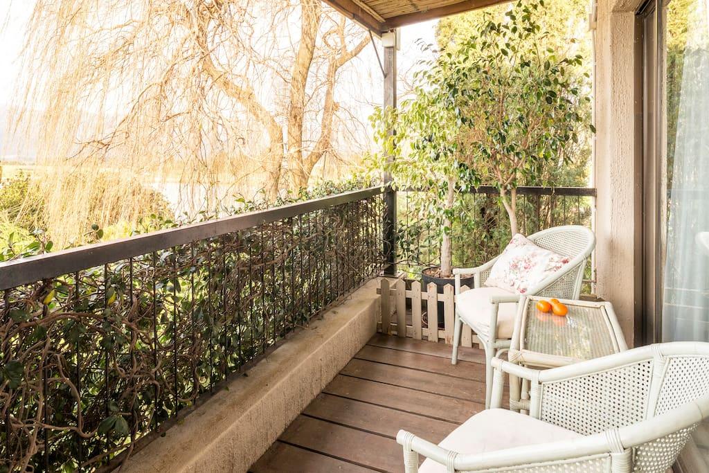 Private balcony overlooking rose garden