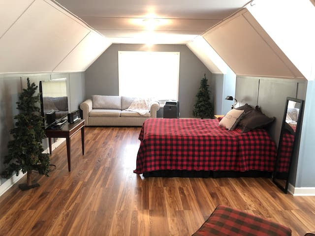 Bedroom upstairs with queen bed and sofa bed. Sleeps four (this room is available as individual Airbnb listing for smaller groups)