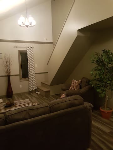 living room and stairs to 2 bedrooms