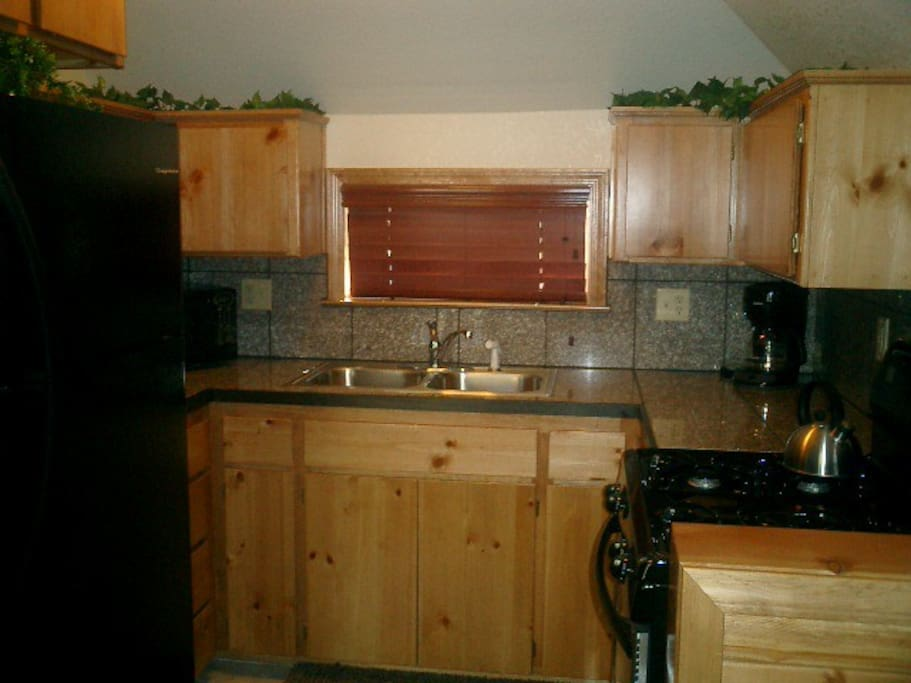 Kitchen with stove top, microwave, toaster, fridge, coffee maker!  Home away from  home!