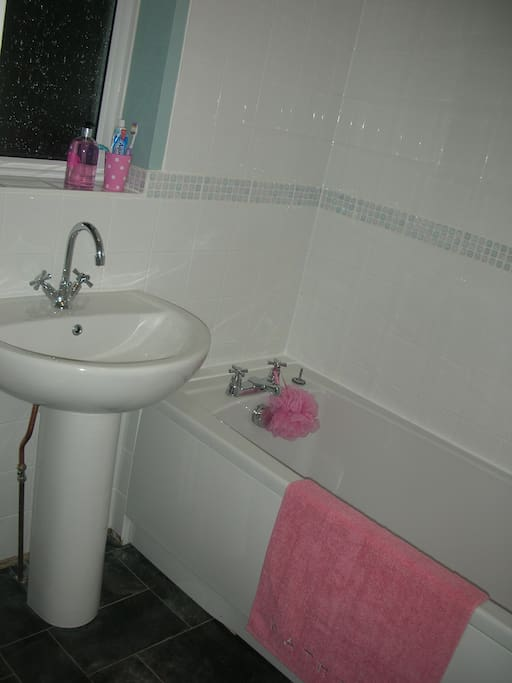 Clean and functional bathroom with bath/shower, only fitted two years ago