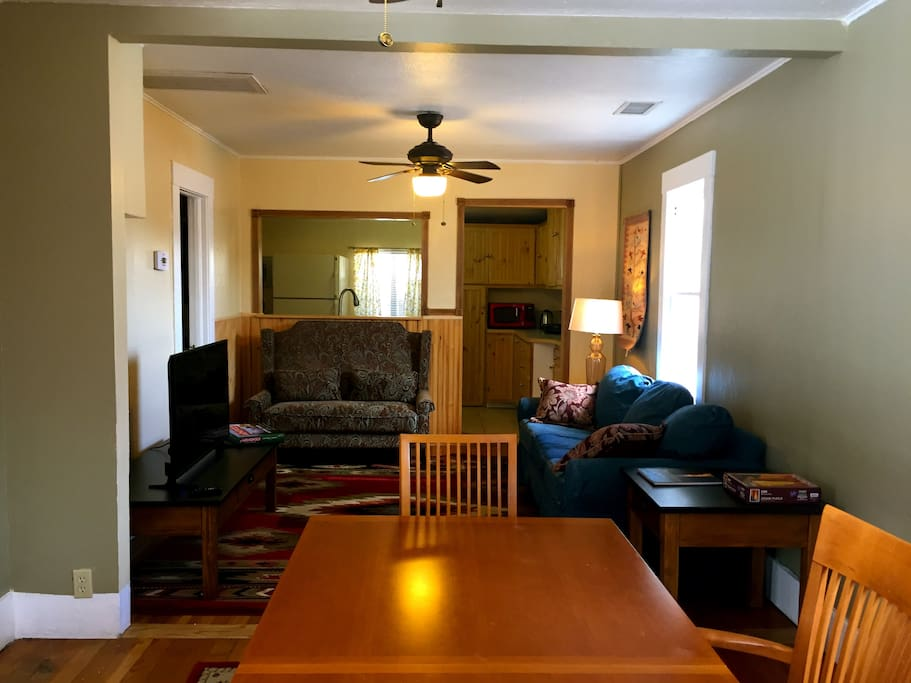 Dining and living room, with a pull-out bed couch.