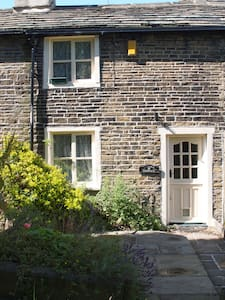 Beautiful 17th century cottage with big inglenook fireplace and exposed beams with large rooms and nice gardens.