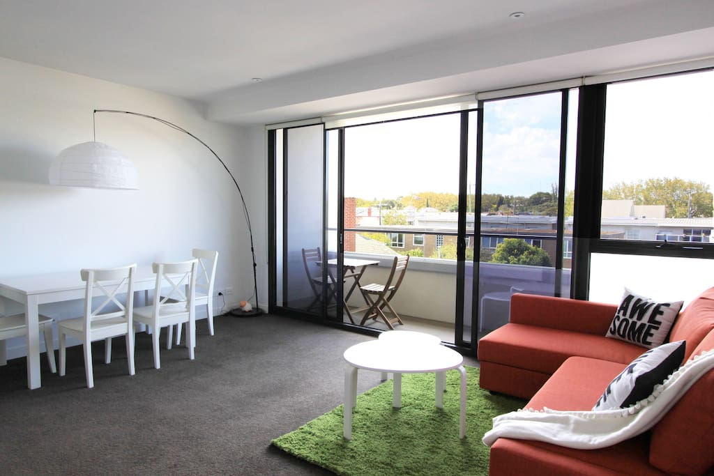 Spacious balcony with outdoor setting and beautiful view