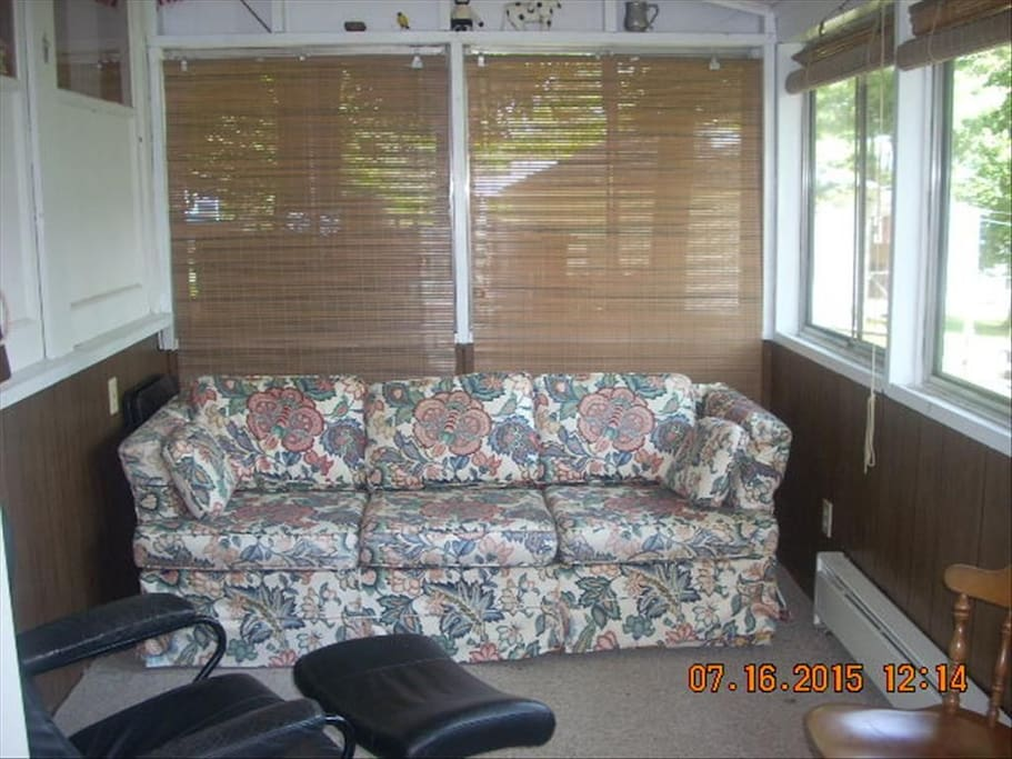 Queen sofa bed on screened in porch.