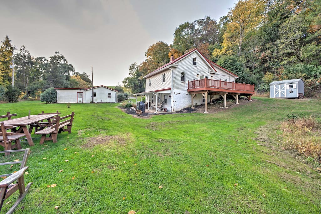 Situated atop more than 4 lush acres of land, this property offers a plethora of outdoor amenities.