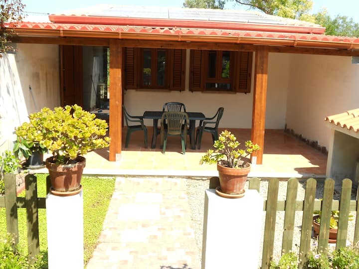 Monolocale con patio + terrazza con veranda