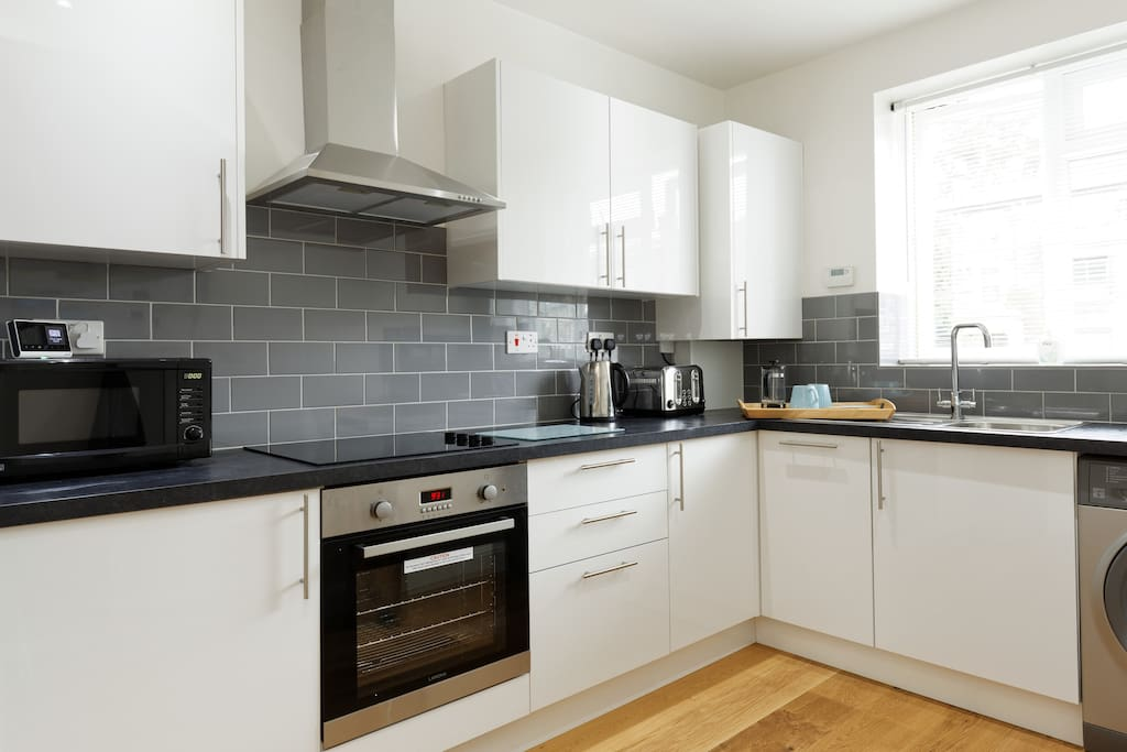 Fully equipped kitchen with, large fridge freezer, dishwasher, wash machine, hob, oven, microwave and toaster all available for guests to use