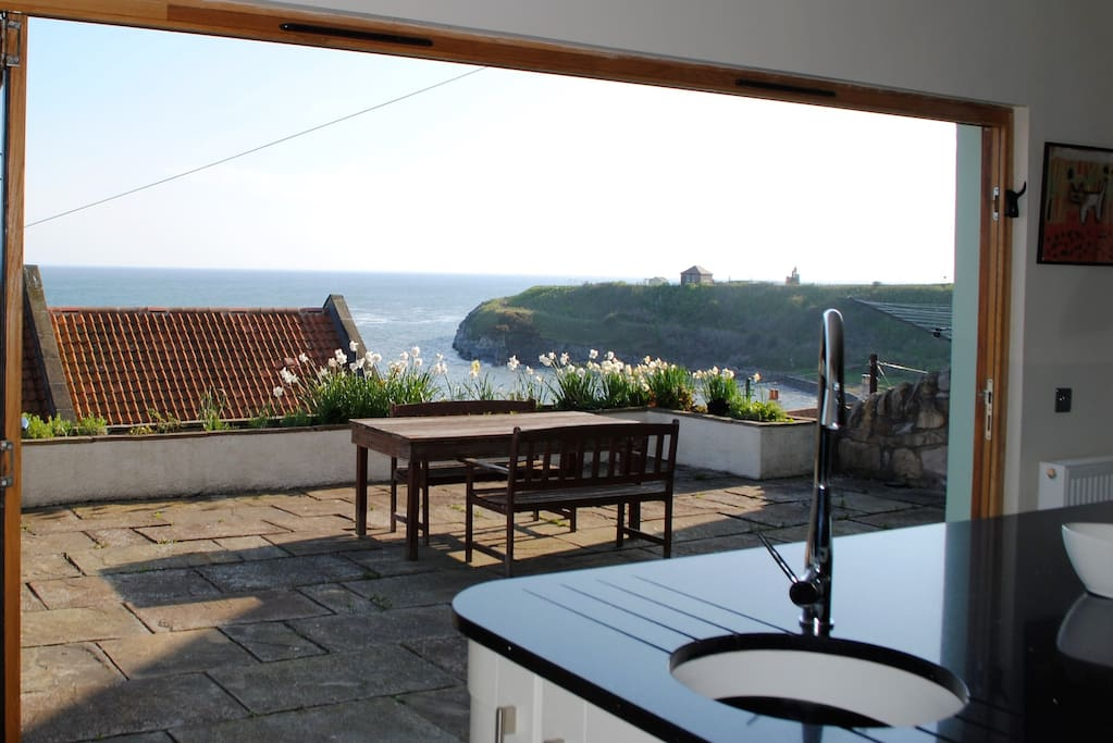 Anchor House brings the outside in with this high spec kitchen opening onto the terrace