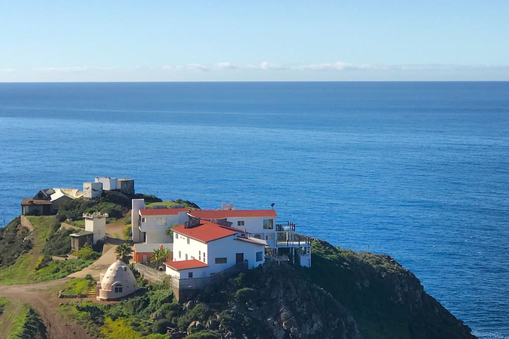 Our Baja Bluff. Our properties include all homes with red roofs and the Eco Dome in the lower right.