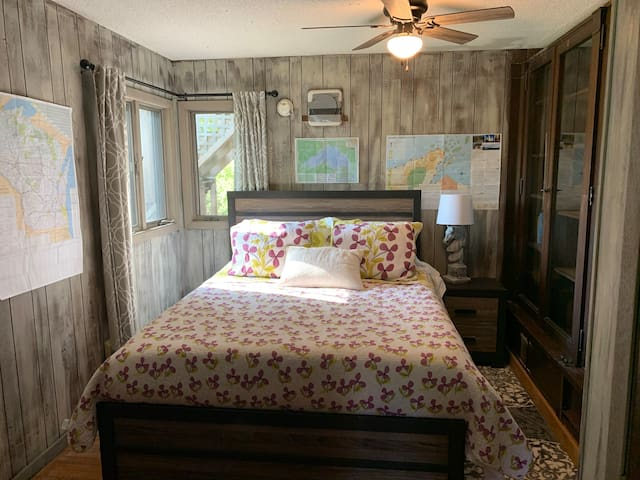 """Not a fan of stairs?  The """"Map Room"""" is our first floor bedroom with a firm, new, luxury Seally mattress.  It may not be a king, but but it does contain a queen bed."""