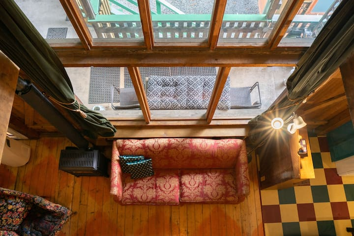 View directly down from the attic loft. Cozy cabin!